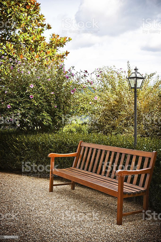 Wooden Bench in a Garden, Tuscany royalty-free stock photo