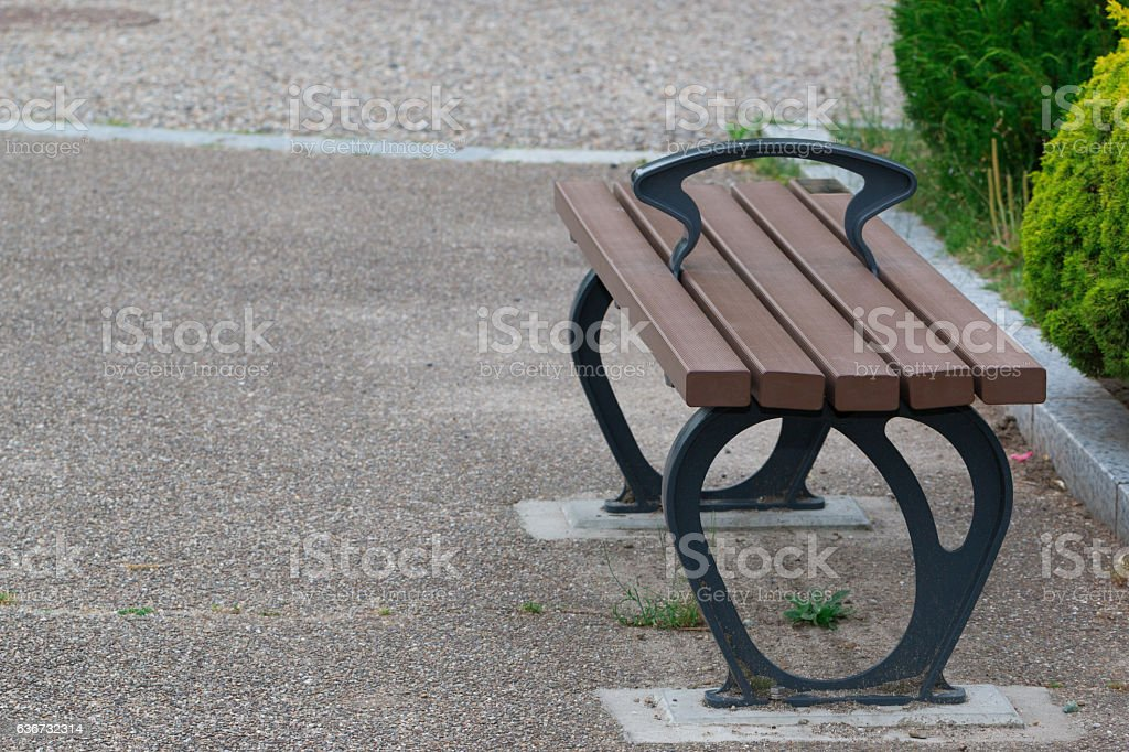 wooden bench in park, concept feeling loneliness. stock photo