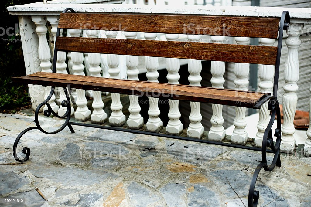Wooden bench on teracce stock photo