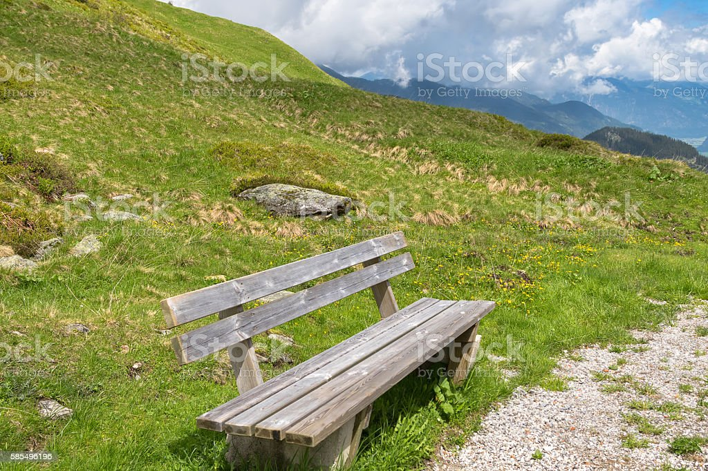 Wooden bench provided for hikers to rest while hiking, Zillertal stock photo