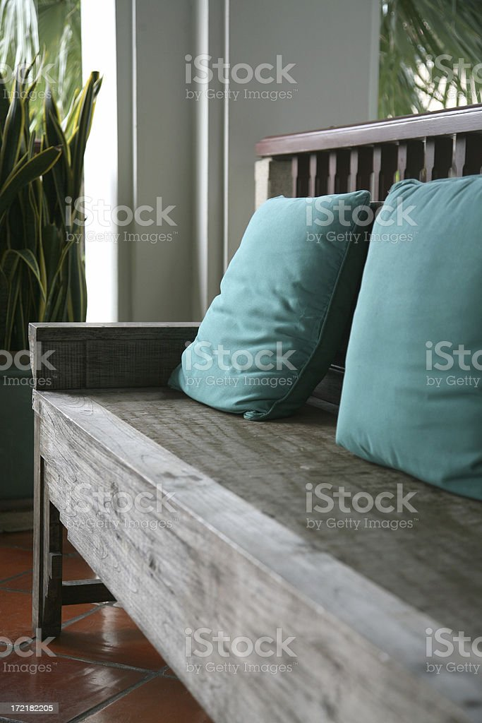 Wooden Bench With Seat Cushion royalty-free stock photo