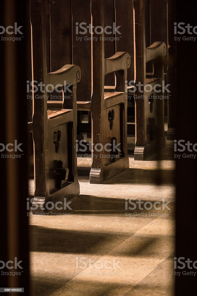 wooden benches in a church stock photo
