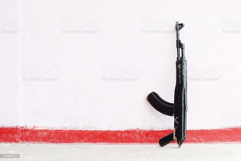 Wooden black toy Kalashnikov rifle stock photo