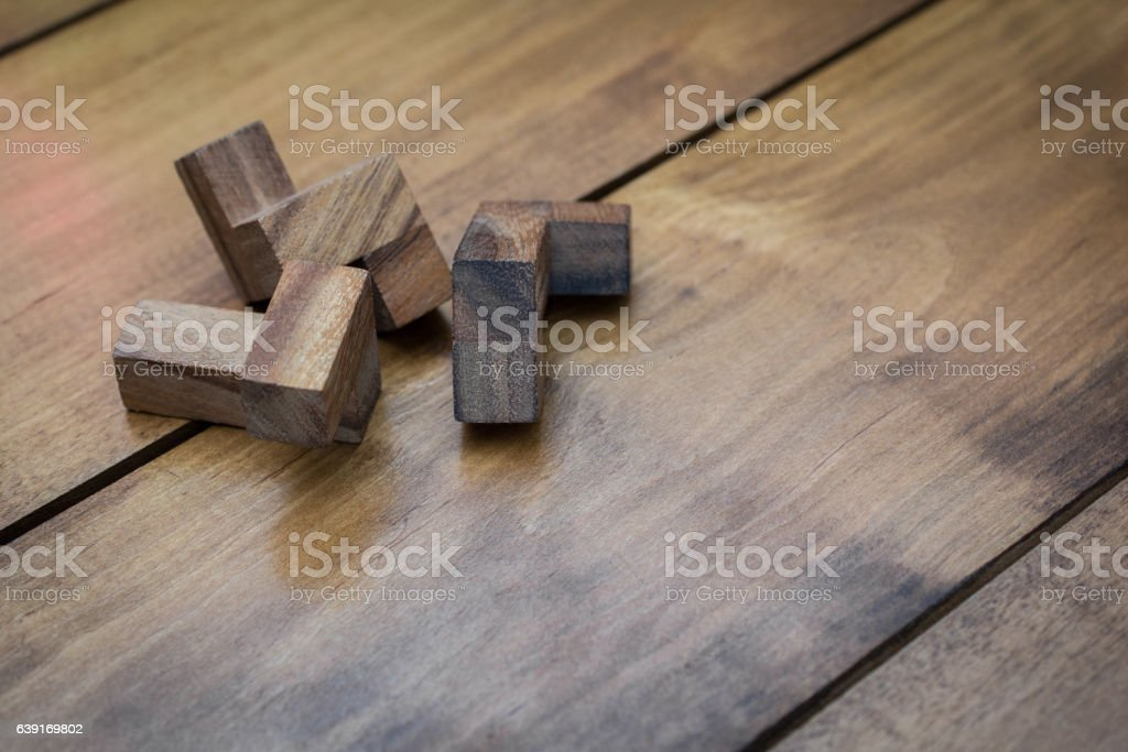 Wooden Block Brain Teaser Puzzle on Wood Background Individual P stock photo