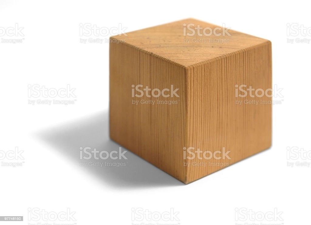 A wooden block on a white background stock photo