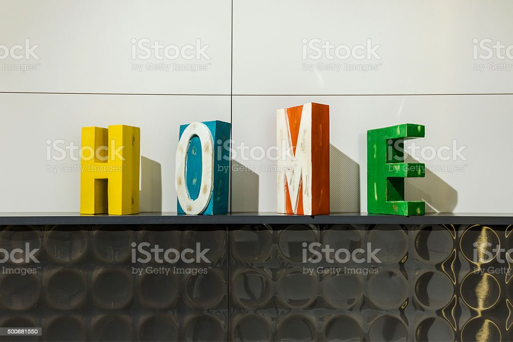 wooden blocks decorative home letters on ceramic surface stock photo