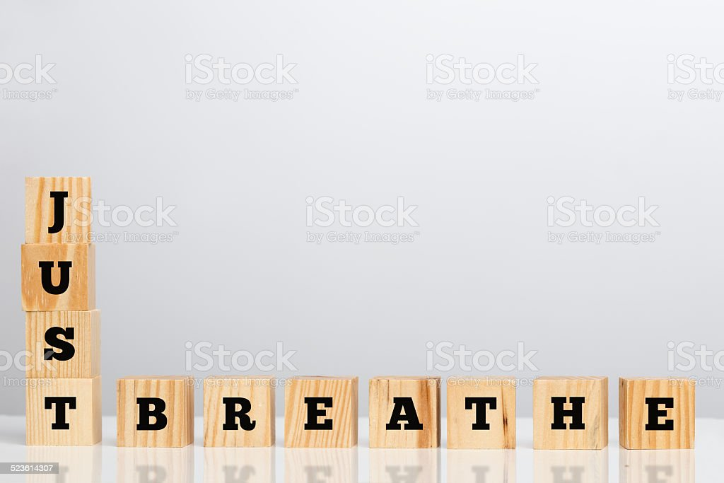 Wooden blocks spelling - Just Breathe stock photo