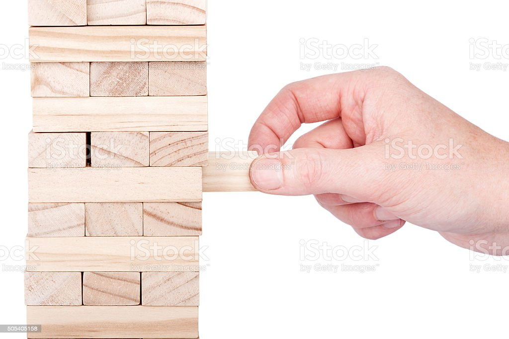 Wooden blocks tower and a hand stock photo