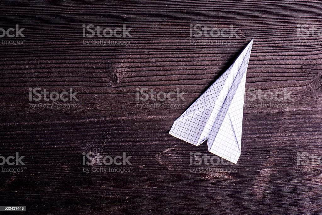 Wooden board background, textured plank, paper airplane, copy sp stock photo