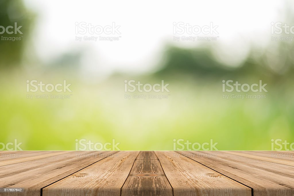 Wooden board empty table blur trees in forest background. stock photo