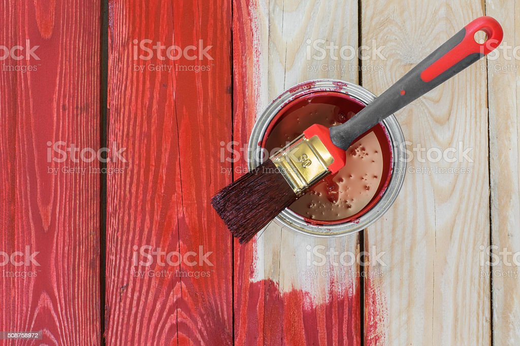 Wooden Board With a Can of Paint at Painting stock photo