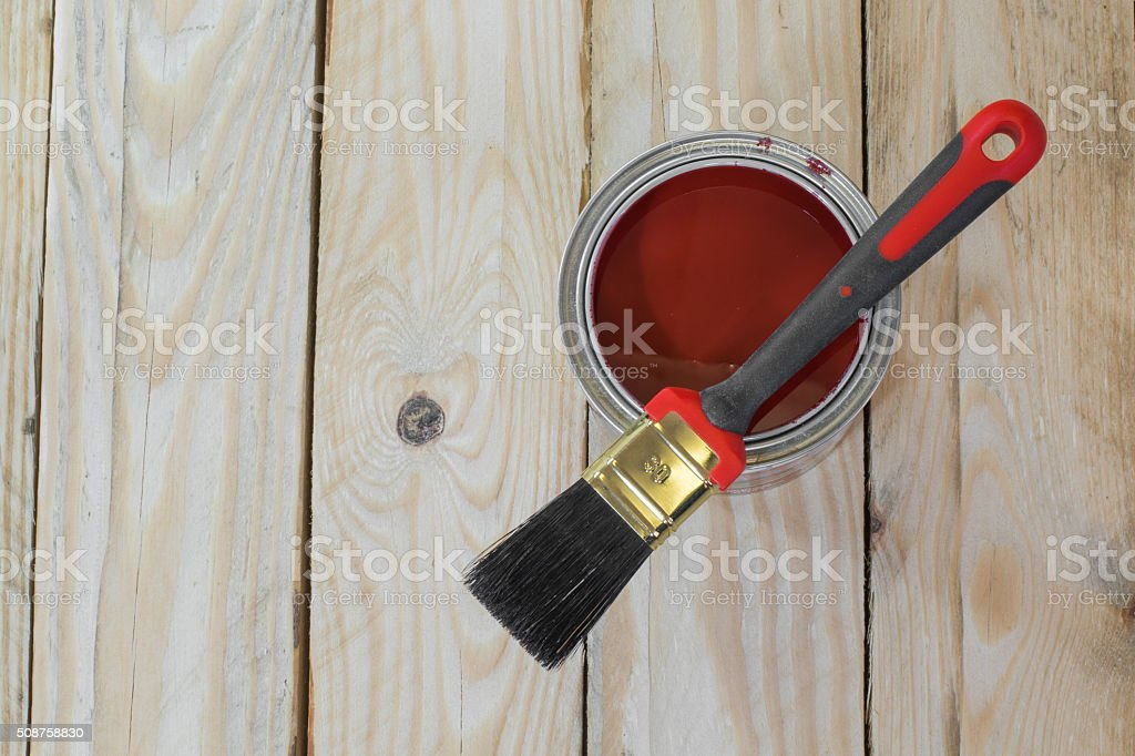 Wooden Board with a Can of Paint before Painting stock photo
