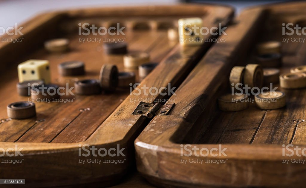 wooden Board with backgammon, pawns, dice, close up stock photo