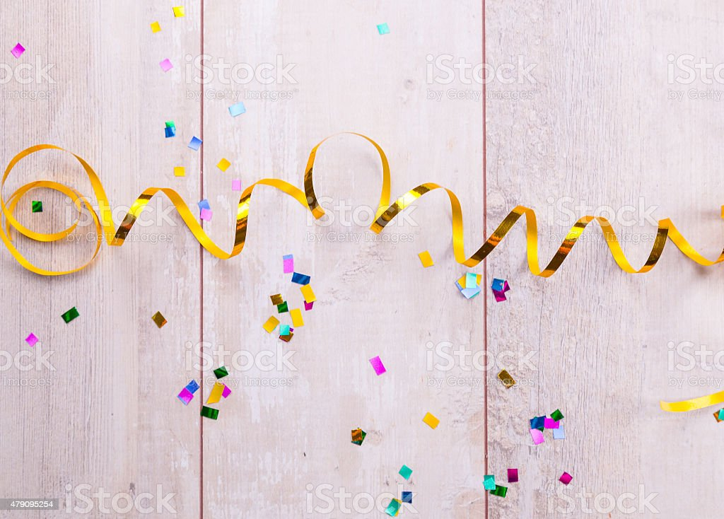 Wooden board with colorful streamers stock photo