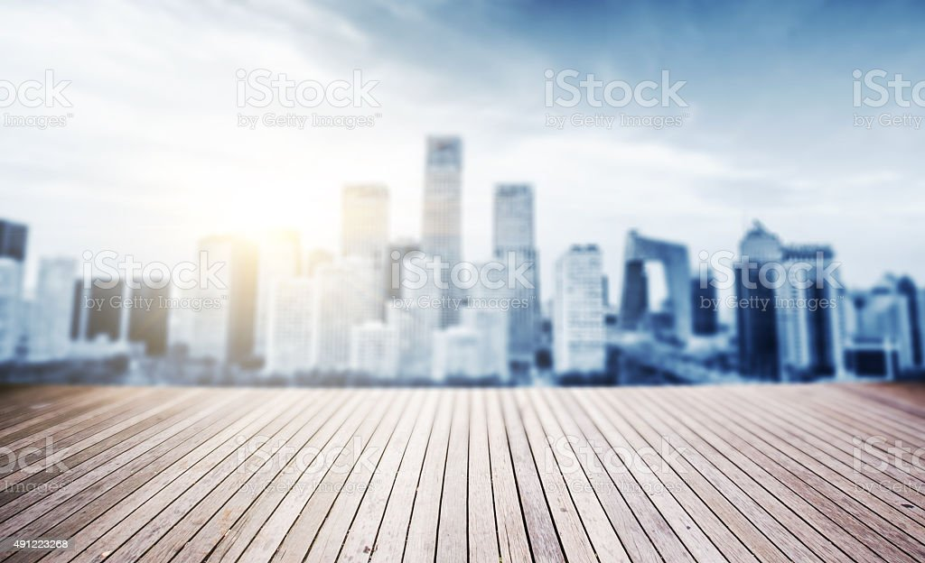 wooden board with defocus city background stock photo