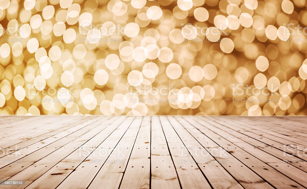 wooden board with defocused lights stock photo