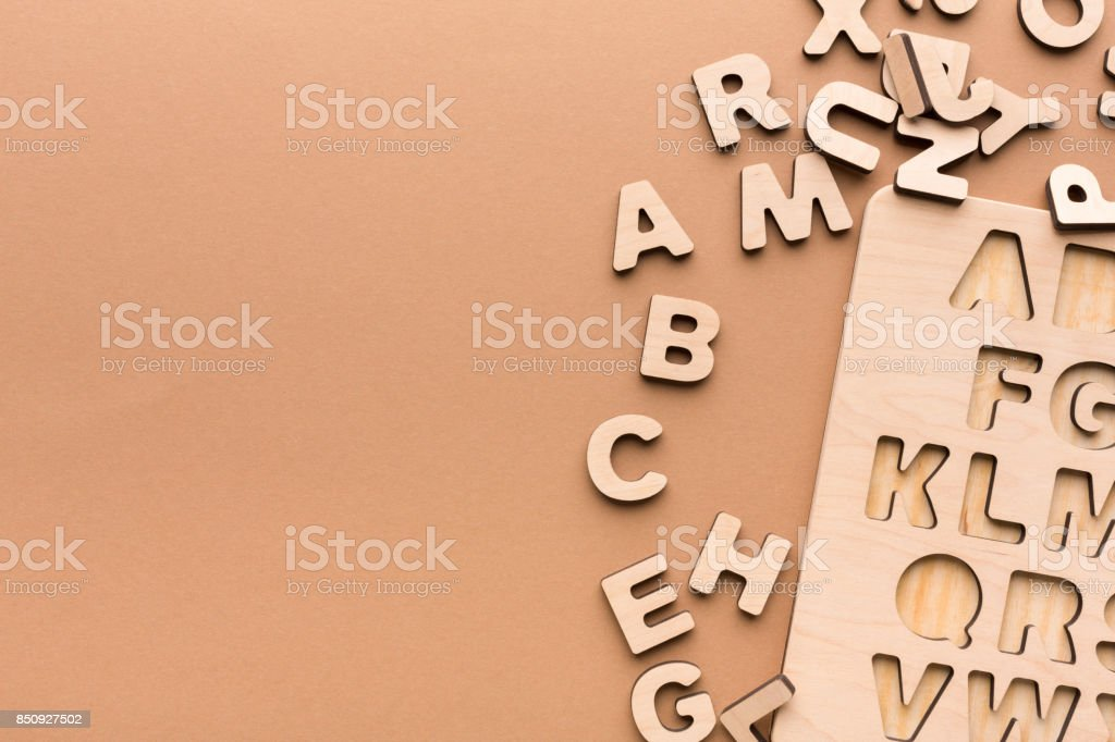 Wooden board with English alphabet letters stock photo