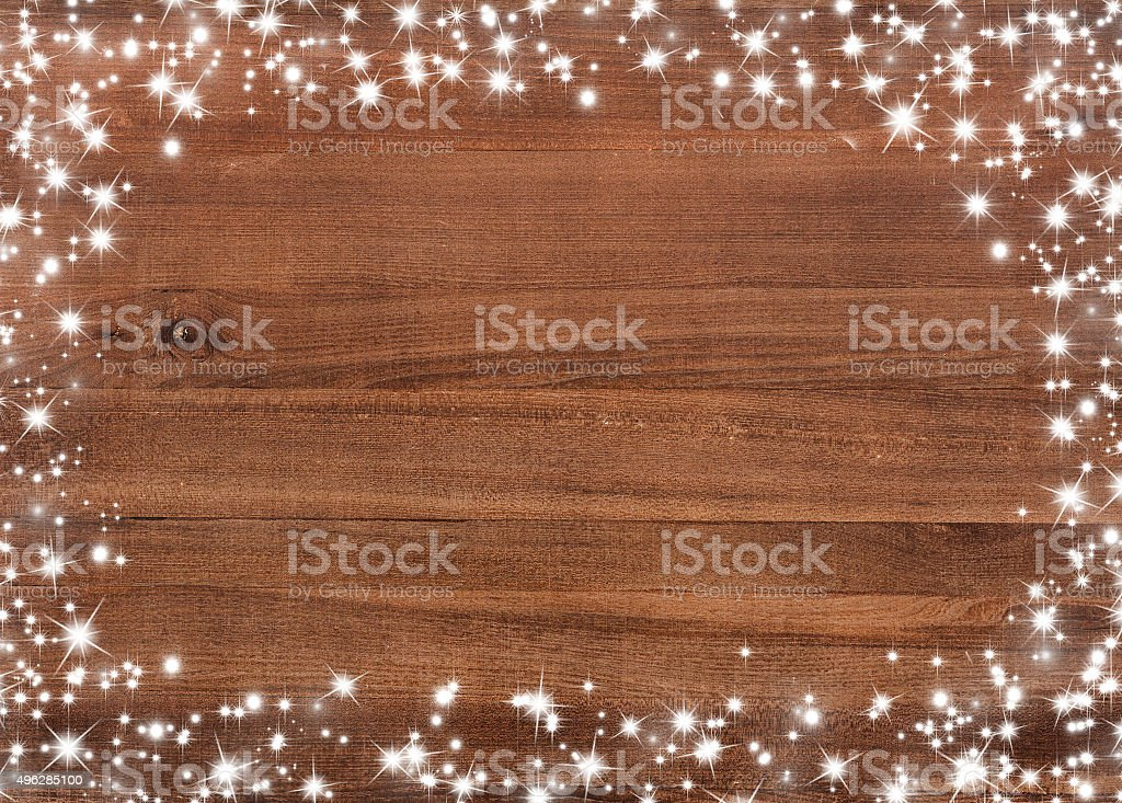 Wooden board with snow flakes . Christmas background stock photo