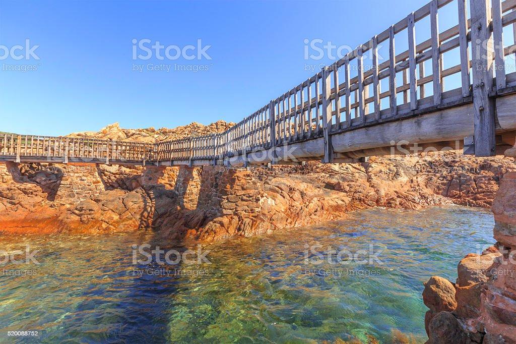 Wooden Boardwalk across thr Gushing Sea Water stock photo