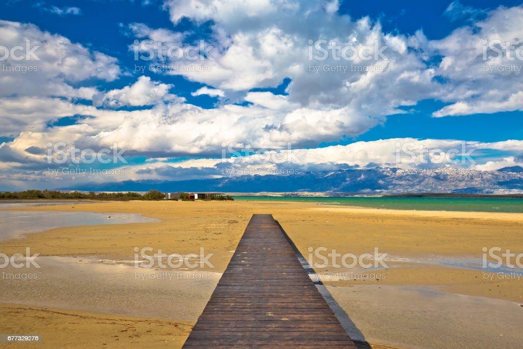 Wooden boardwalk and sand beach of Nin, Dalmatia, Croatia stock photo