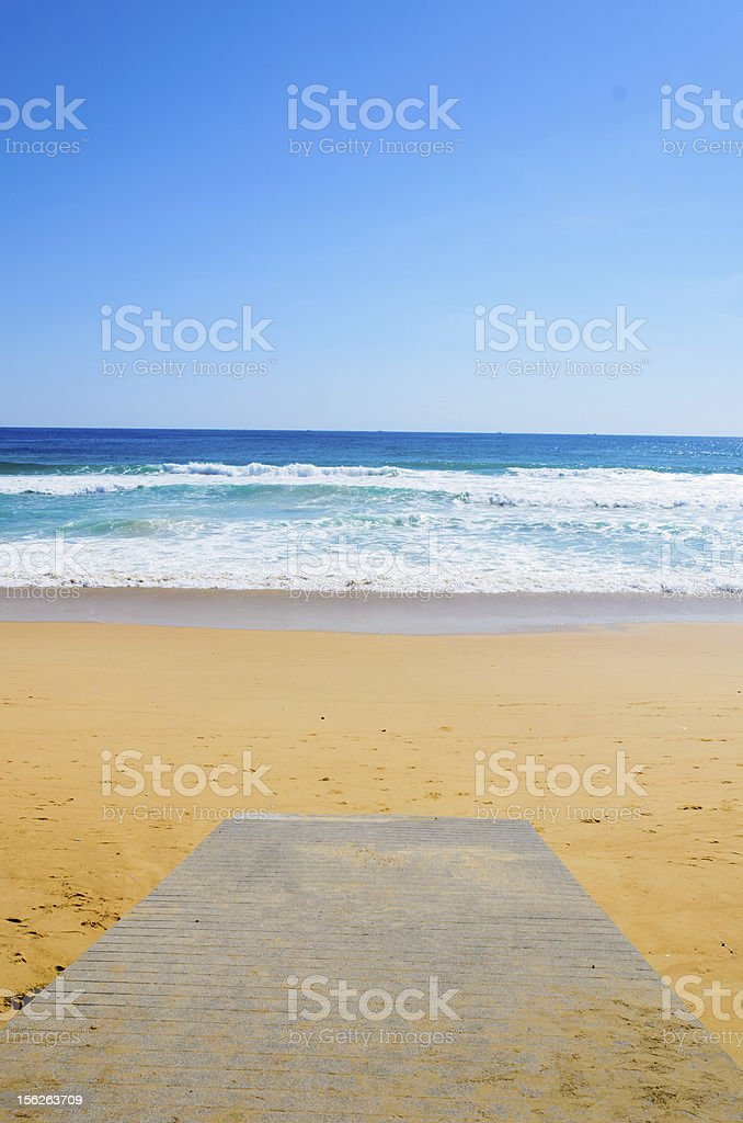 wooden Boardwalk on the beach and tropical sea royalty-free stock photo