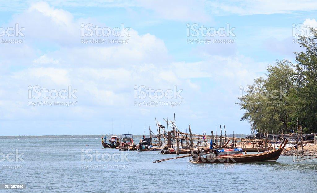Деревянная лодка в рыбацкий поселок Стоковые фото Стоковая фотография