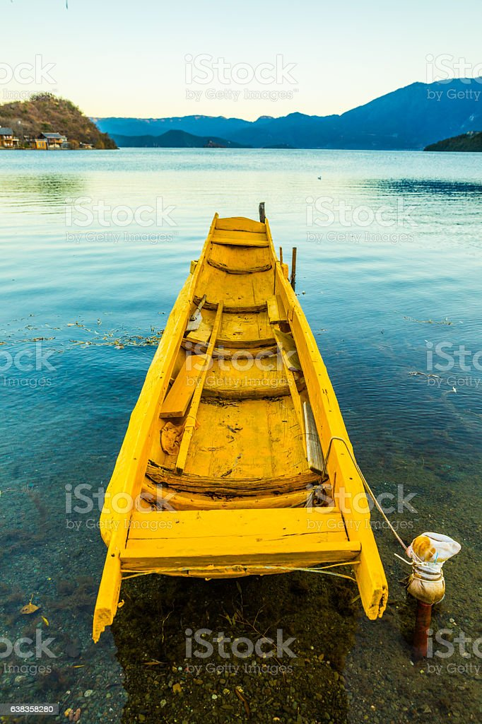 Wooden boat in Lugu Lake,Yunnan stock photo