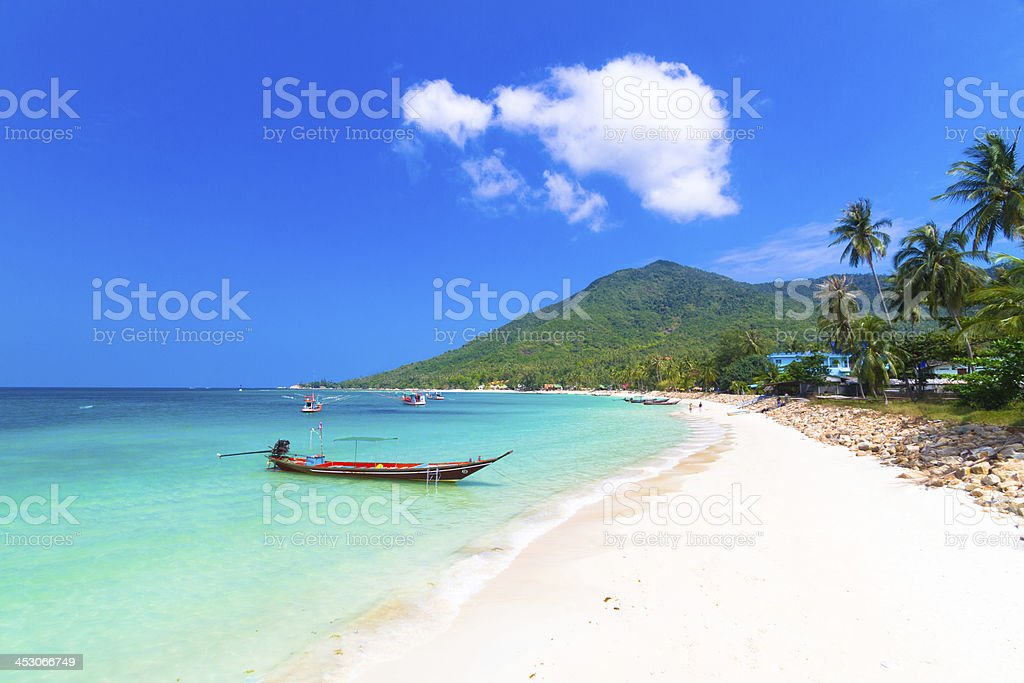 Wooden boat on Phi island, Thailand. stock photo