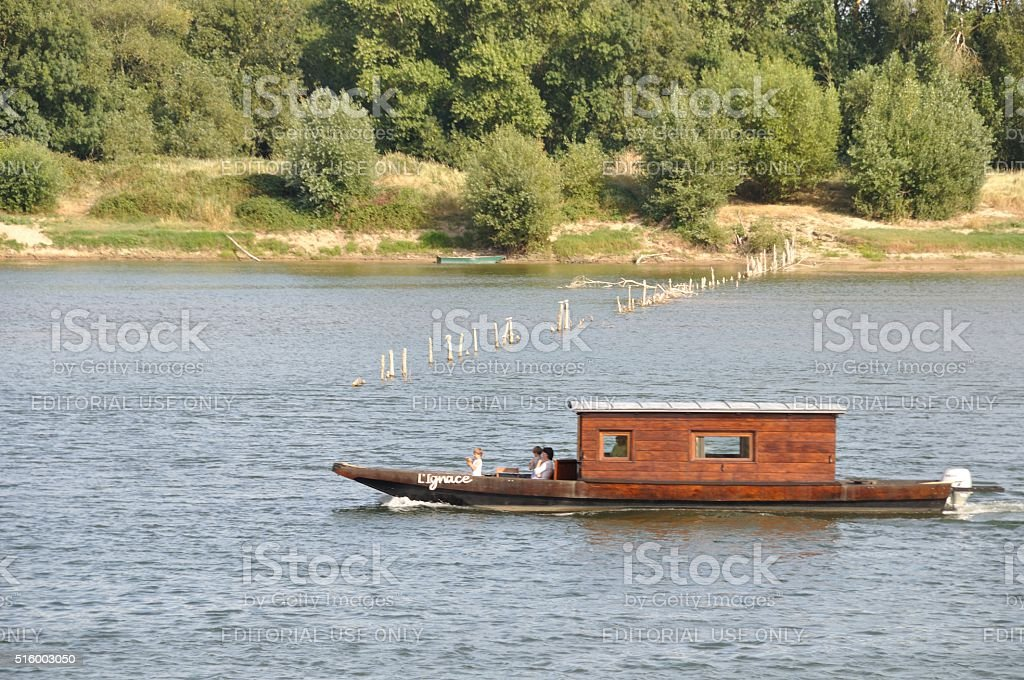 Wooden boat on the Loire river stock photo