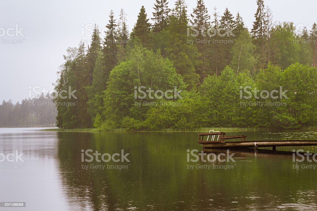 Wooden boat pier on lake. Palvaanjarven Campsite, Lappeenranta stock photo