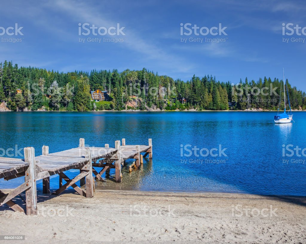 Wooden boat pier on the lake stock photo