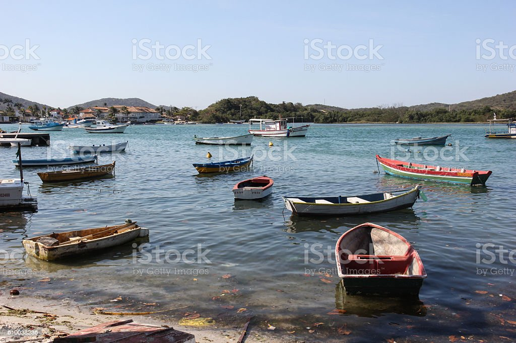 Wooden boats anchored in connection channel with the sea stock photo