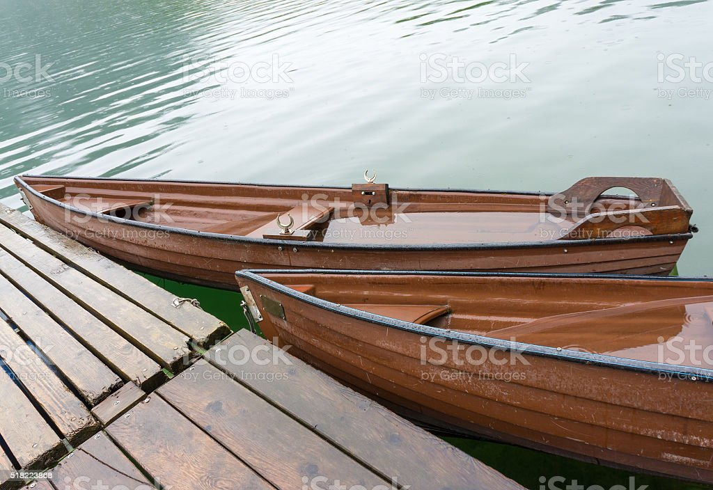 Wooden boats at pier stock photo