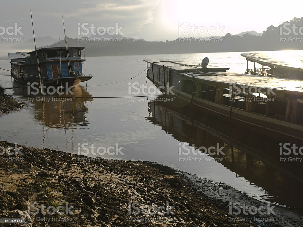 wooden boats on a sunset river royalty-free stock photo
