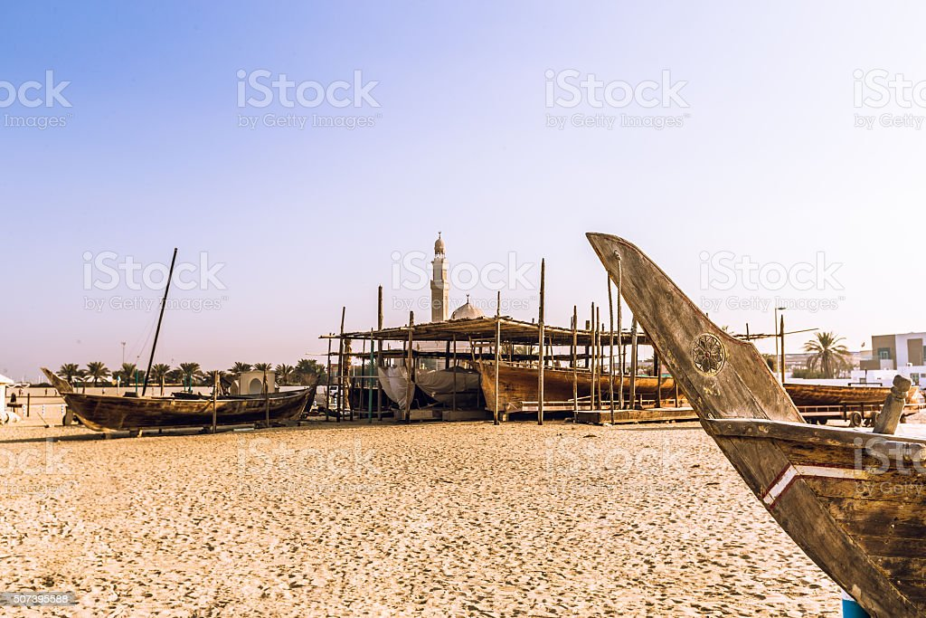 Wooden boats on an open beach of Dubai, UAE stock photo