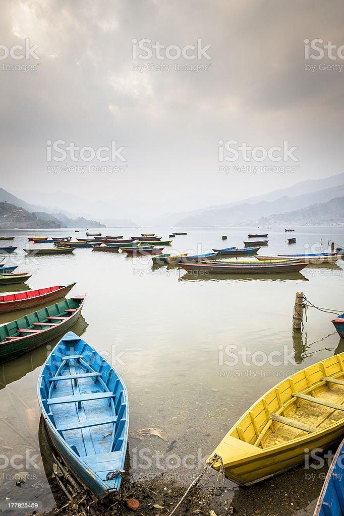 Wooden boats on Fewa Lake in Pokhara royalty-free stock photo