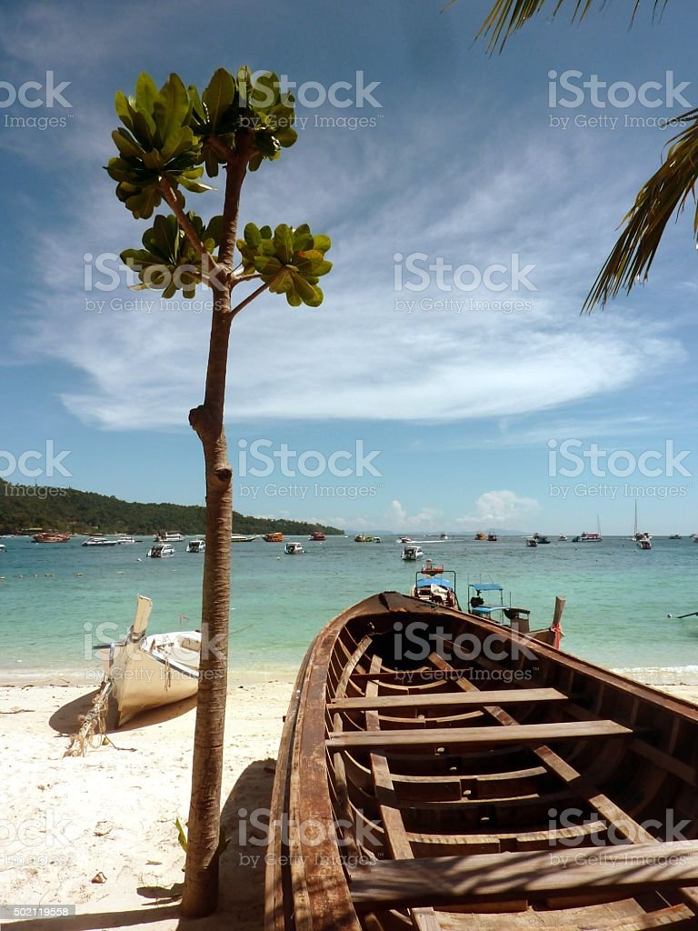 Wooden Boats on PhiPhi island white sand beach, Thailand stock photo