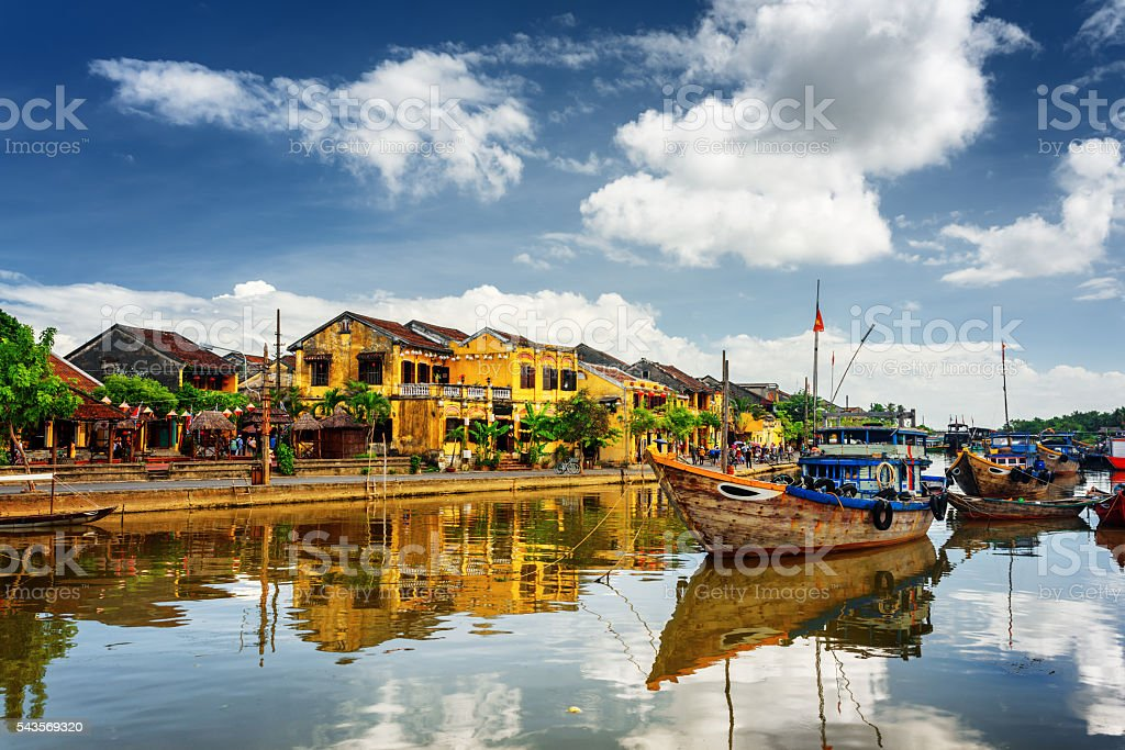 Wooden boats on the Thu Bon River, Hoi An, Vietnam stock photo