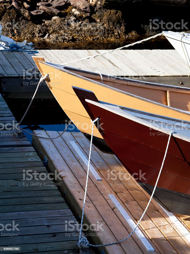 Wooden Boats Tied At A Dock stock photo