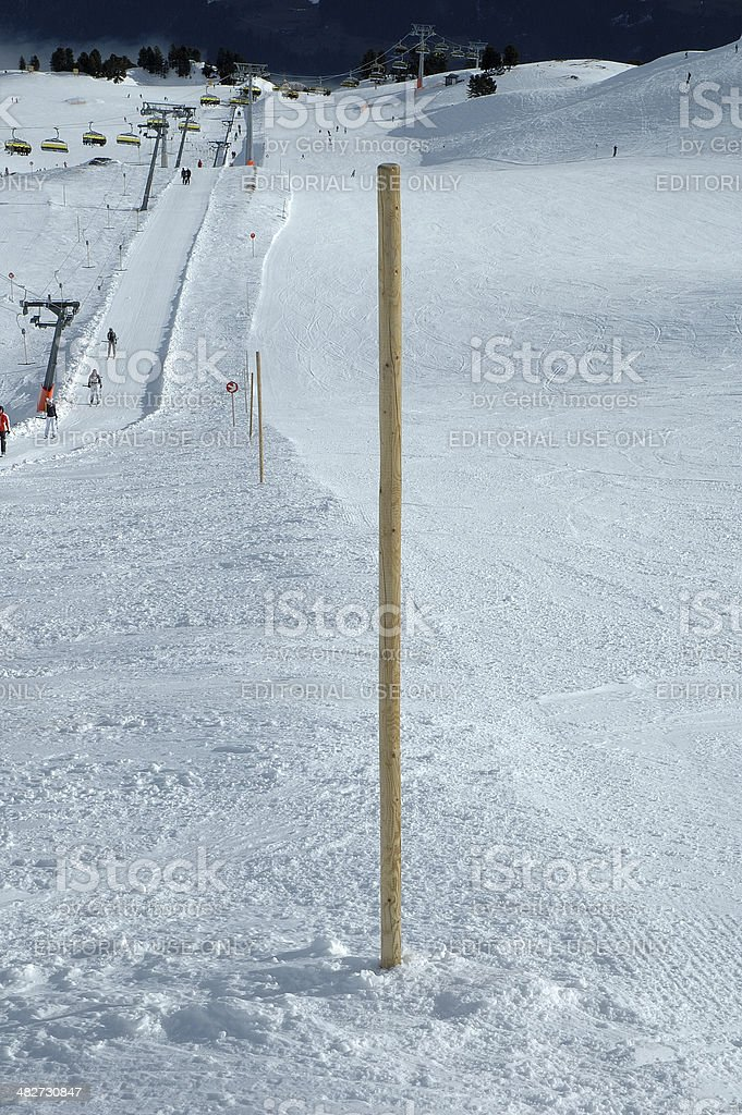 Wooden bollard nearby slope stock photo
