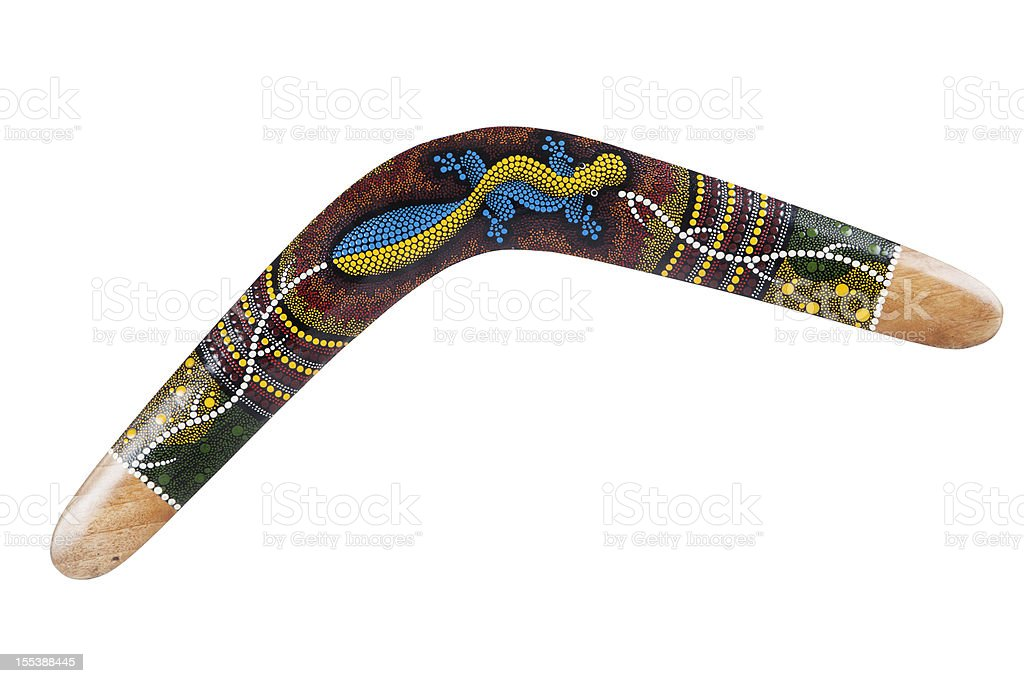 Wooden boomerang pattern decorated with lizards stock photo