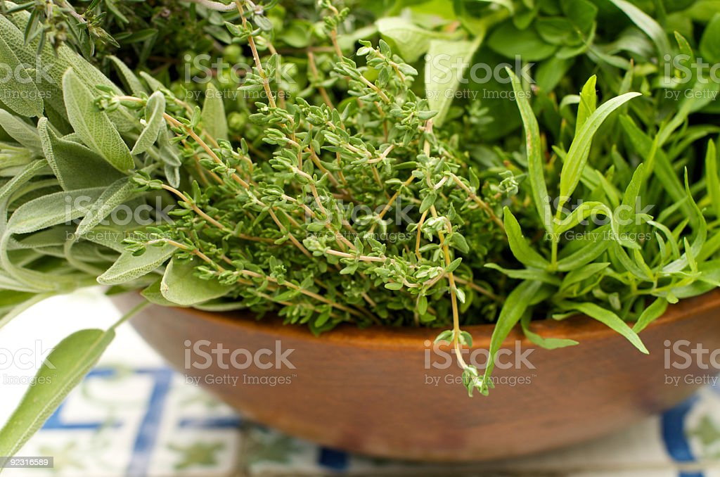 Wooden Bowl Filled with Herbs from the Garden stock photo