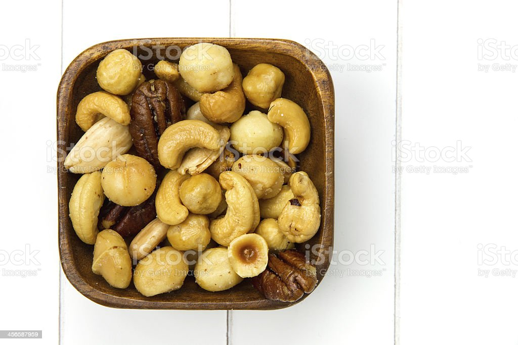 wooden bowl filled with nuts royalty-free stock photo