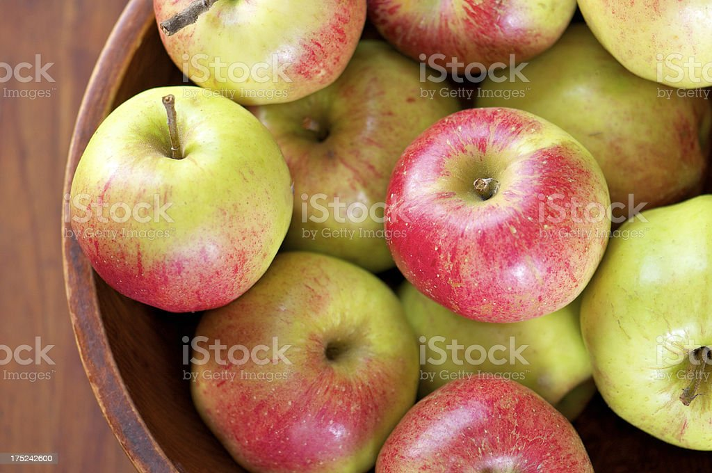 Wooden Bowl of Freshly Picked Apples from Above royalty-free stock photo