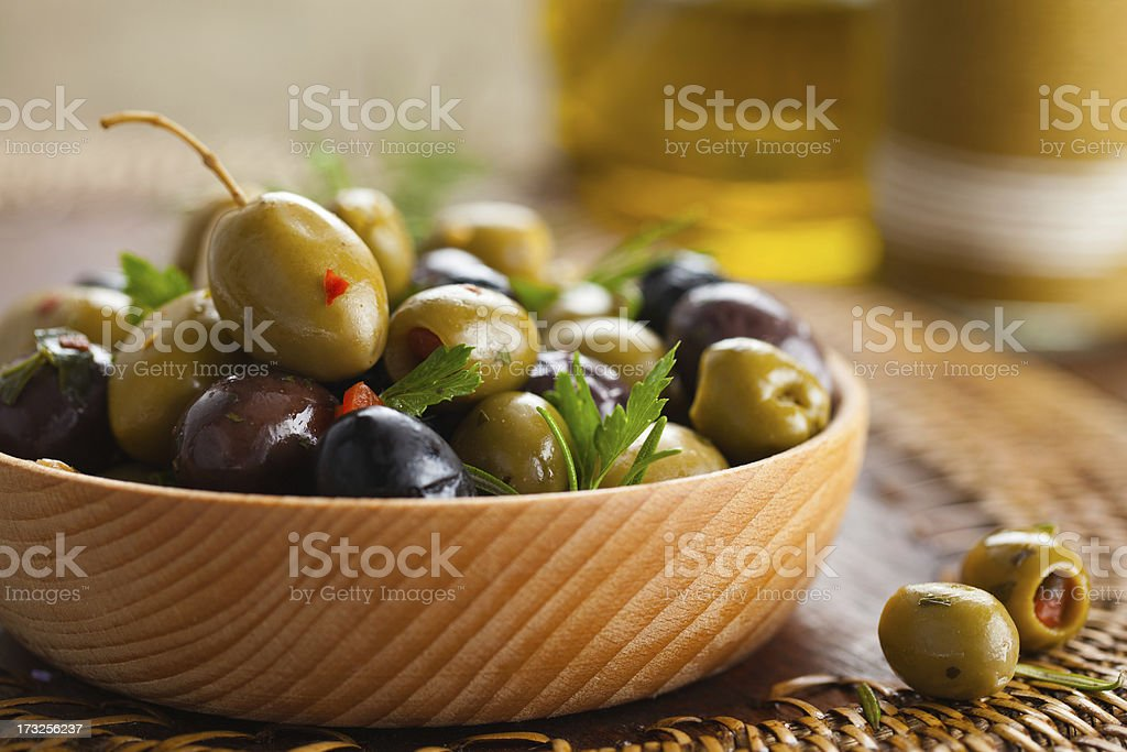 A wooden bowl of green and black olives royalty-free stock photo