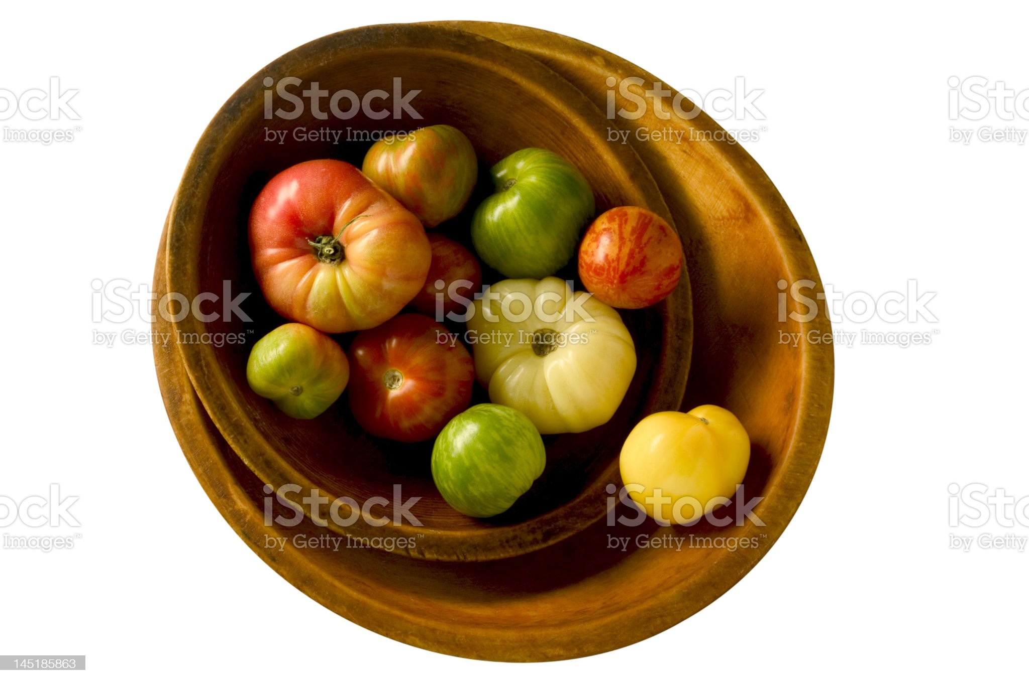 wooden bowl of heirloom tomatoes royalty-free stock photo