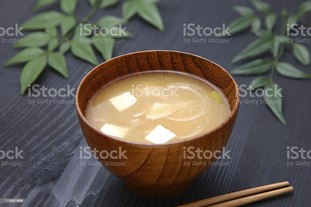A wooden bowl of Japanese miso soup stock photo