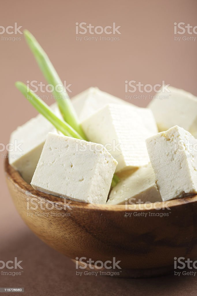Wooden bowl of tofu with fresh green beans royalty-free stock photo