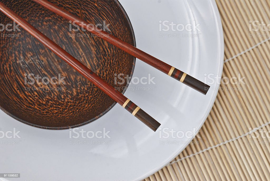 Wooden bowl with chopsticks 4 royalty-free stock photo