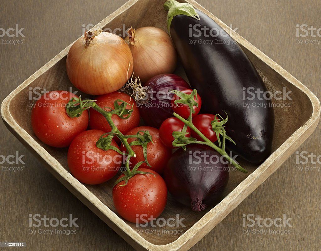 Wooden bowl with  fresh vegetables royalty-free stock photo
